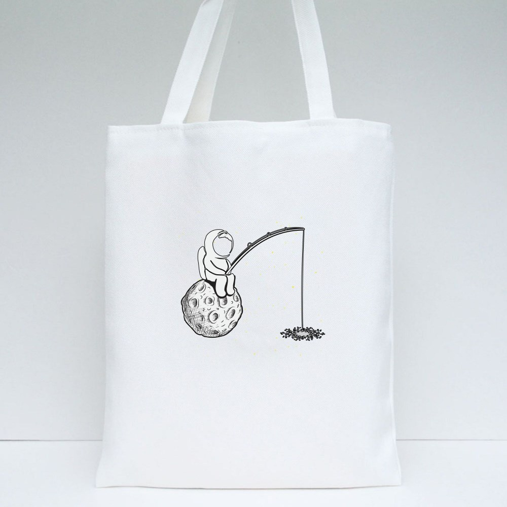 Astronaut Fishing on the Moon Tote Bags