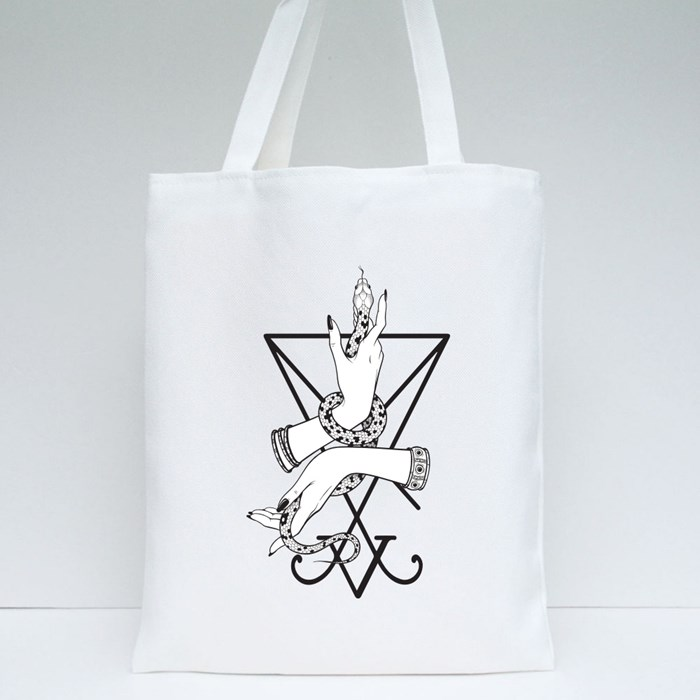 Serpent in Female Hands Tote Bags