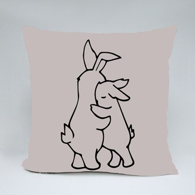 Two White Rabbits Hugging Throw Pillows