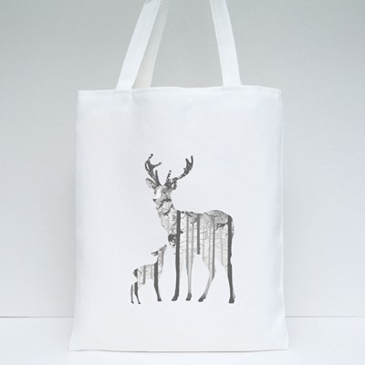 Silhouette of a Deer With a Small Deer. Inside the Deer Is a Pine Fore Tote Bags