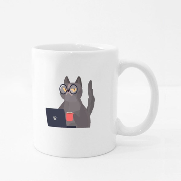 Funny Cat in Glasses Sits at a Laptop and Holds a Cup of Coffee