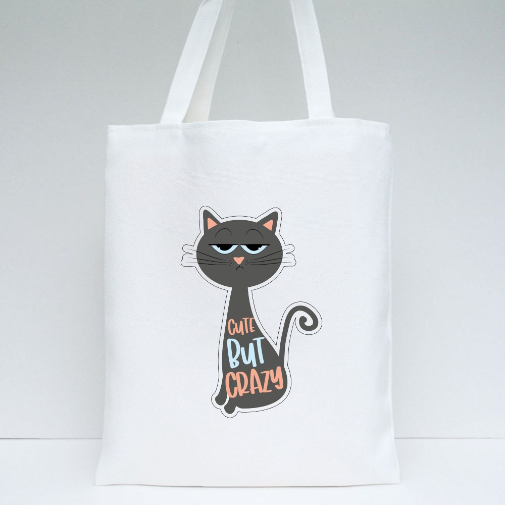 Cute but Crazy Funny Text With Grimacing Cat Tote Bags