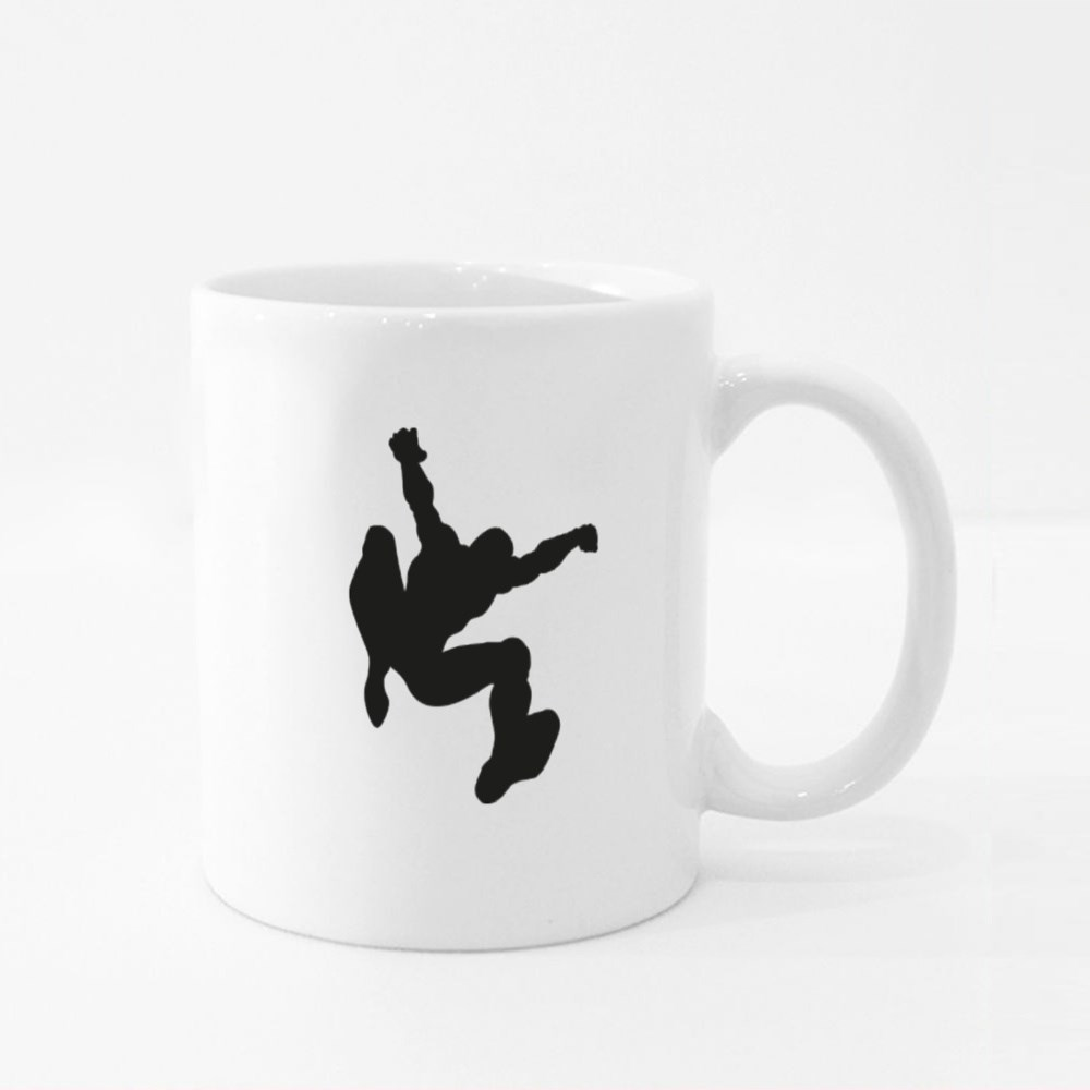 Silhouette of a Jumping Hero Colour Mugs